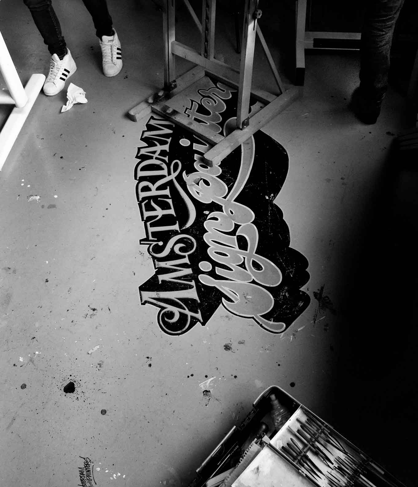 Amsterdam Signpainters logo on studio floor